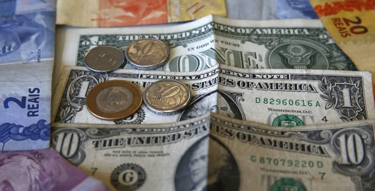 Dólar Divisa Caída del petroleo: Dólar alcanza nuevamente la barrera de los 3.100 pesos