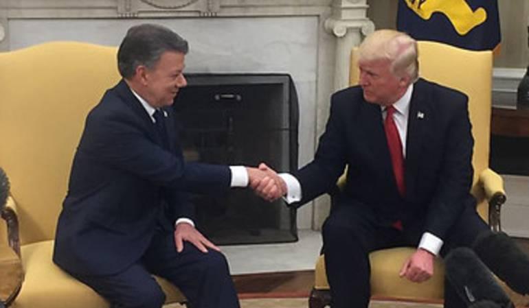 Los mandatarios, Santos y Trump.