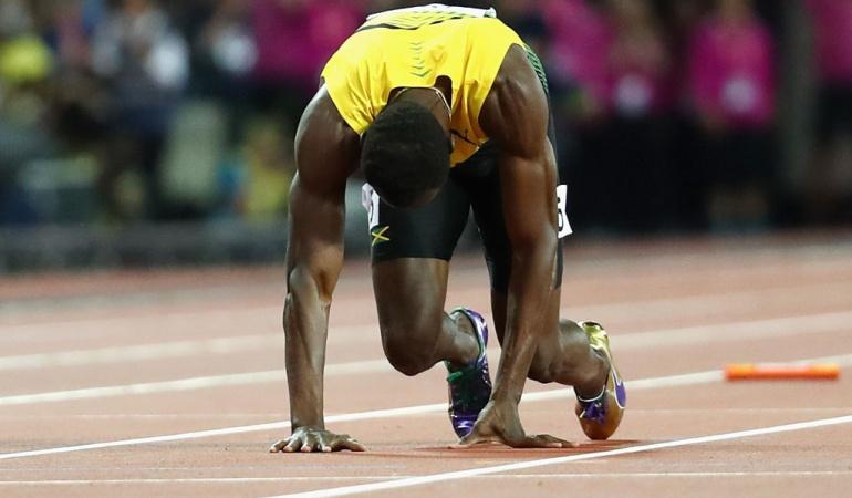 Usain Bolt lesión 4 x 100 Mundial Atletismo retiro: Usain Bolt no pudo terminar la última carrera de su trayectoria deportiva