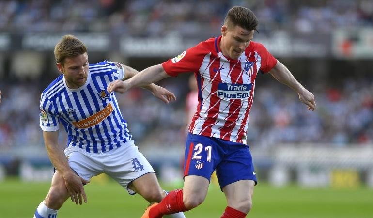 barcelona liga yerry mina: Real Sociedad vence al Atlético y Barcelona queda a un partido del título