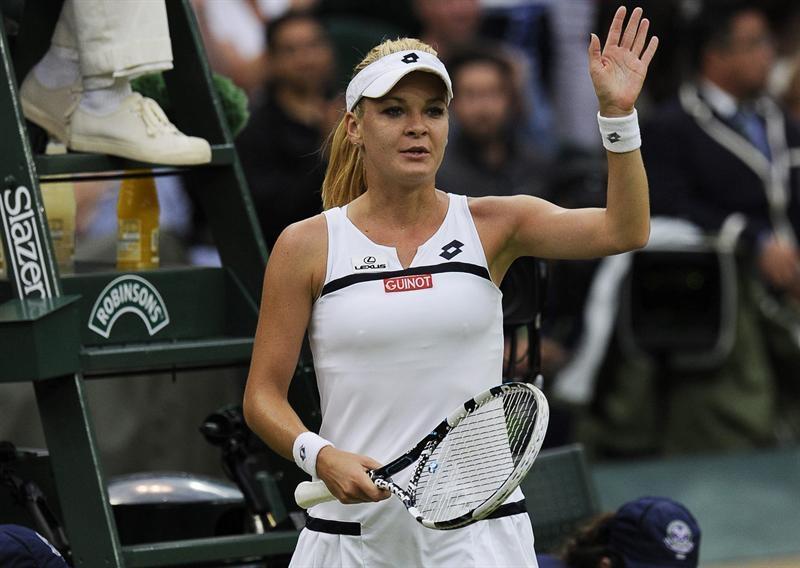 La tenista polaca Agnieszka Radwanska celebra su victoria en el partido de cuartos de final del torneo de tenis de Wimbledon.