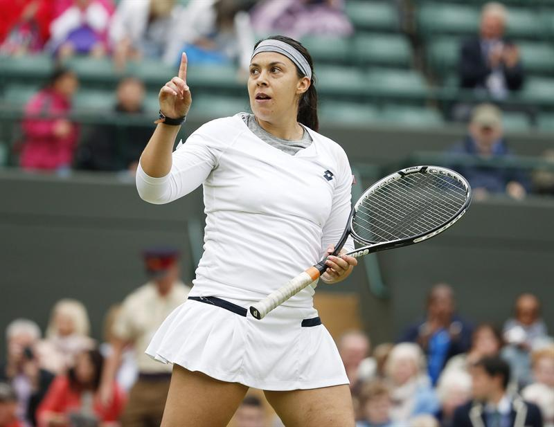 La tenista francesa Marion Bartoli reacciona durante el partido de cuartos de final del torneo de tenis de Wimbledon.