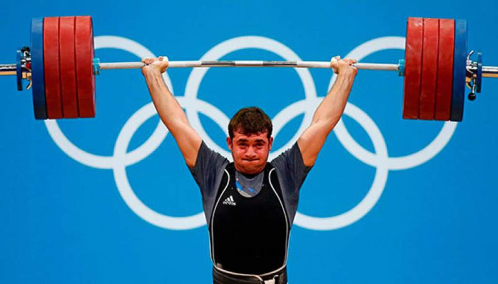 Ganó tres medallas de oro en 100 metros, 200 metros y relevo 4 x 100 en los Juegos Olímpicos de Pekín en 2008 y de Londres en 2012.